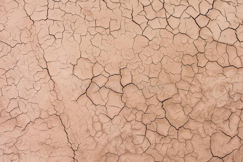 Dry desert soil ground sand cracked texture pattern. From drone stock images