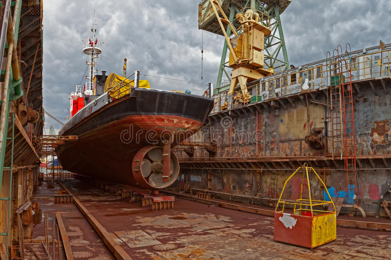 Dry dock. Ship for repairs in large floating dry dock royalty free stock photography