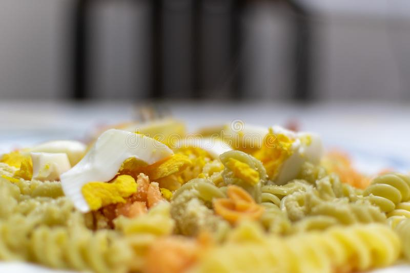 durum wheat pasta with vegetables and cooked egg stock photo