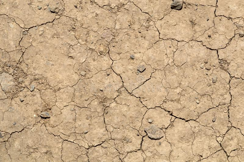 Dry earth with cracks on arid soil surface seen from above. Environmental signs of climate change and global warming. Dry earth with cracks on arid soil surface stock photo