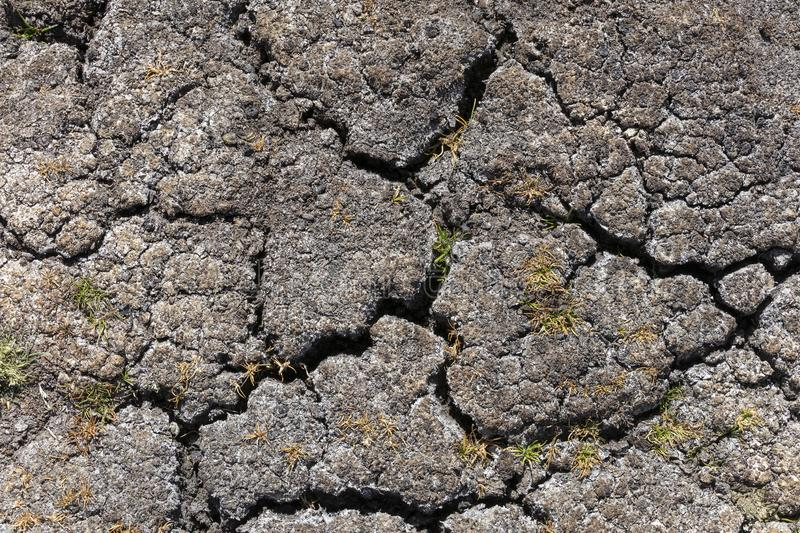 Dry earth with cracks on arid soil surface seen from above. Environmental signs of climate change and global warming. Dry earth with cracks on arid soil surface stock images
