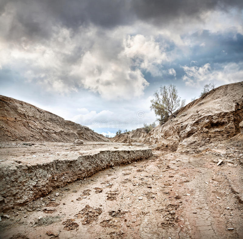 Dry earth and overcast sky. Dry clay earth in steppe of Altyn Emel national park at dramatic overcast sky in Kazakhstan, Central Asia stock photos
