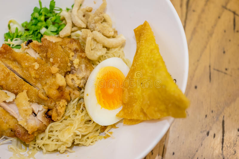 Dry egg noodle with fried chicken stock photos