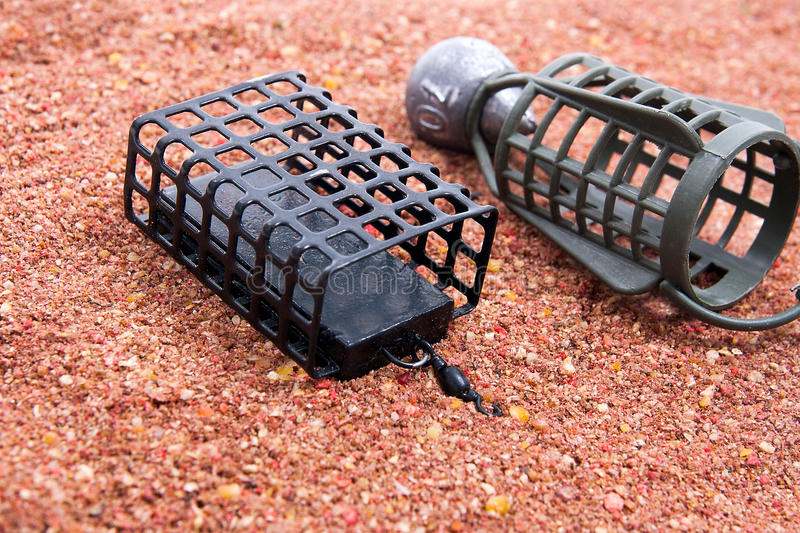 Dry feed for carp fishing as background. Different fishing feeder on fishing feed. royalty free stock photos