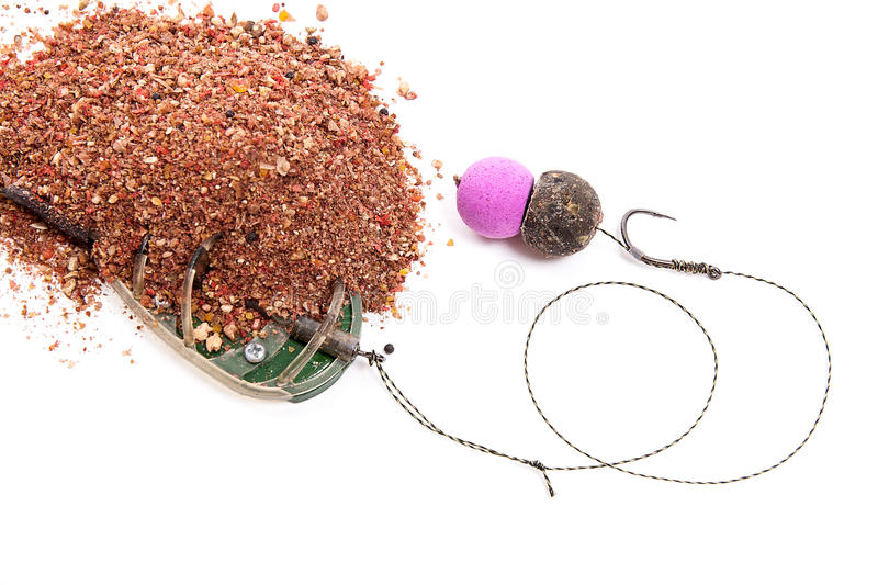 Dry feed for carp fishing. Ready for use Carp bait with fishing. Close up view of fishing baits and Fishing gear for carp. Dry feed for carp fishing. Ready for royalty free stock image