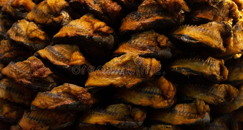 Dry fish in the market , smoked fish. Background royalty free stock images