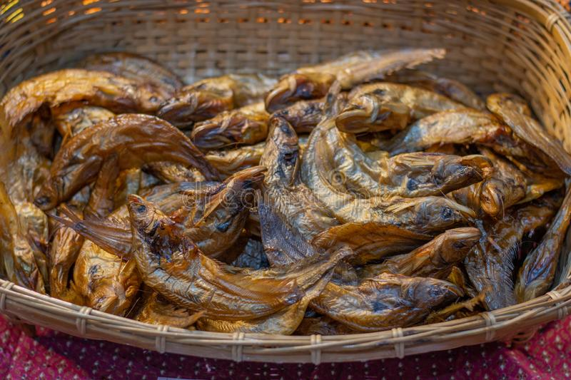 Dry fish in the market , smoked fish. In the basket stock photos