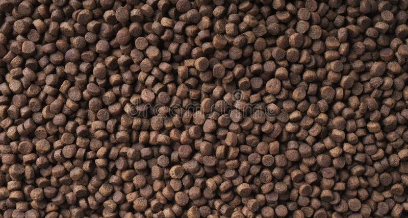 Dry food for cats and dogs. Pet meal background texture. Dry food for cats and dogs. Panoramic pet meal background texture stock image