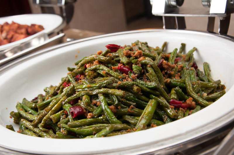 Dry-Fried Green Beans with Minced Pork and Preserved Vegetables stock photo