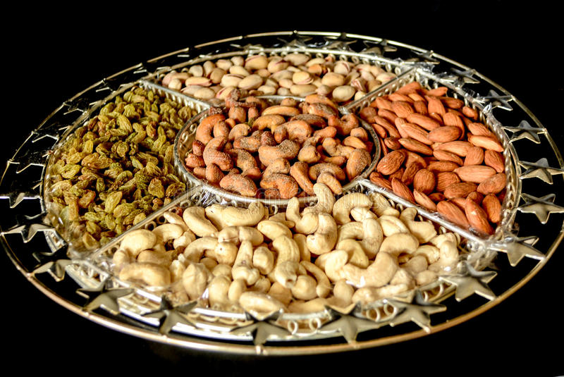 Dry Fruits. Assorted Dry Fruits In An Ornamented Plate royalty free stock images