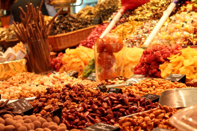Dry fruits market. Exotic dried fruits piles in street market royalty free stock photography