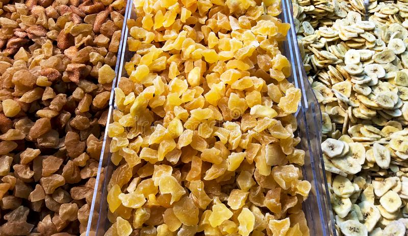 Dry fruits and spices on a scaffohold in a garden market. for healthy and natural concept stock image