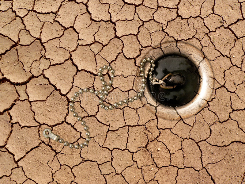 Dry ground. Dry crackled ground with water outflow (view from top royalty free stock photos