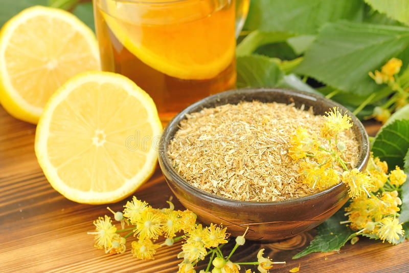 Dry herbal tea with linden flowers royalty free stock photography