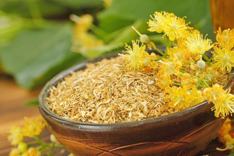 Dry herbal tea with linden flowers royalty free stock photos