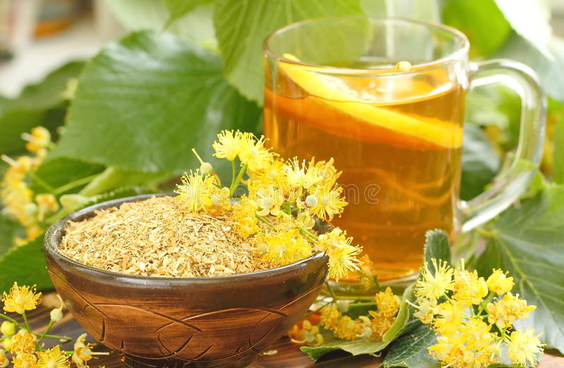 Dry herbal tea with linden flowers royalty free stock photo