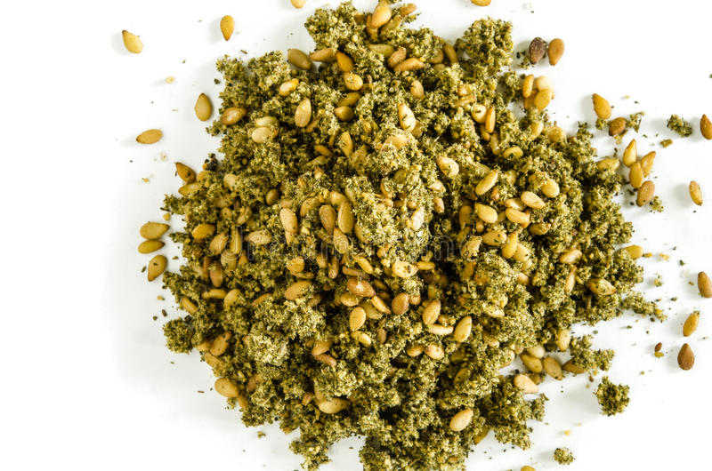 Dry hyssop leaves and seeds heap isolated on white. Food background. Closeup macro shot. Top view stock photography