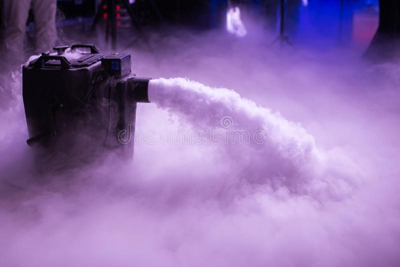 Dry ice low fog machine with hands on for wedding first dance in restaurants stock image