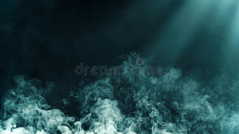 Dry ice smoke clouds fog floor texture. .Blue perfect spotlight mist effect on isolated black background royalty free stock photos