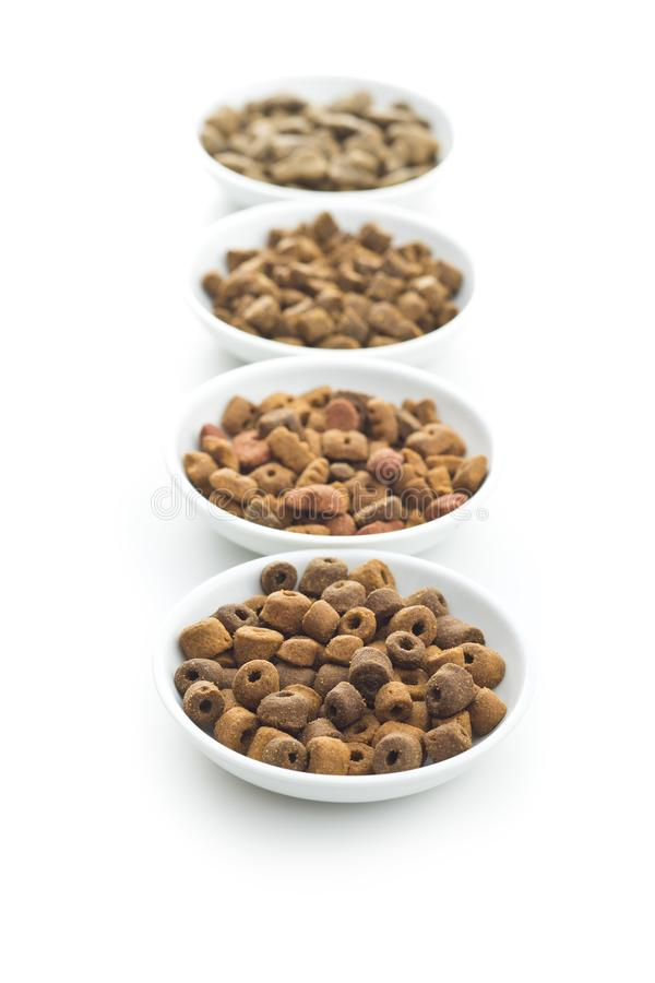 Dry kibble pet food. Kibble for dog or cat royalty free stock image