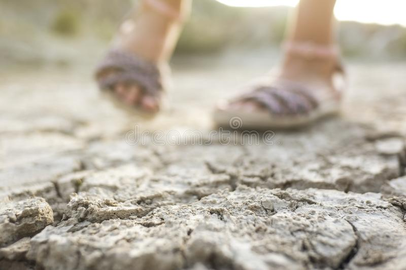 Dry lagoon due to lack of rain after drought, hot summer. Feet detail royalty free stock photos