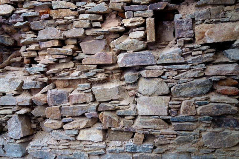 Dry Laid Ancient Stone Wall Foundation. This is a crisp image of a very old antique wall made dry stacked stone with some degradation and erosion with missing royalty free stock photos