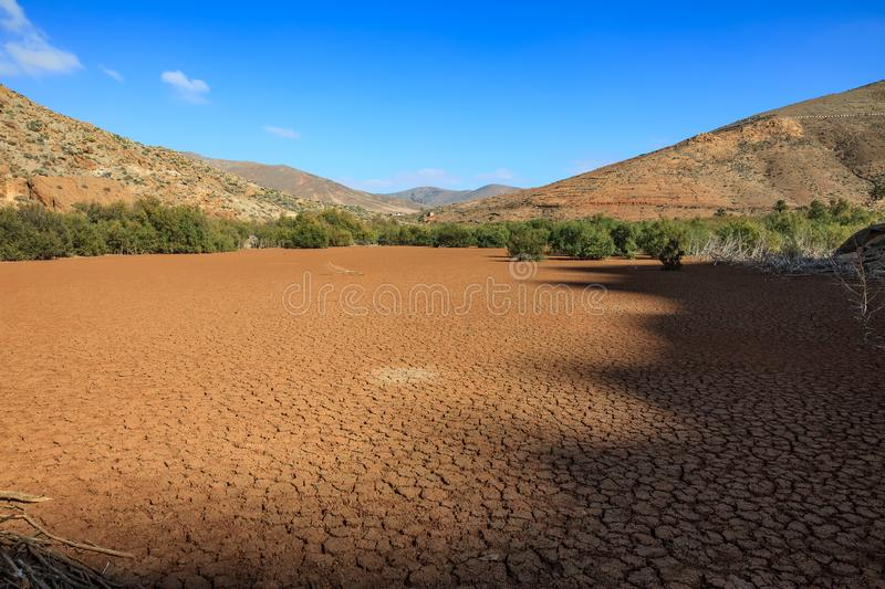 Dry lake with cracked earth. On rural park Betancuria, Fuerteventura, Canary islands royalty free stock image