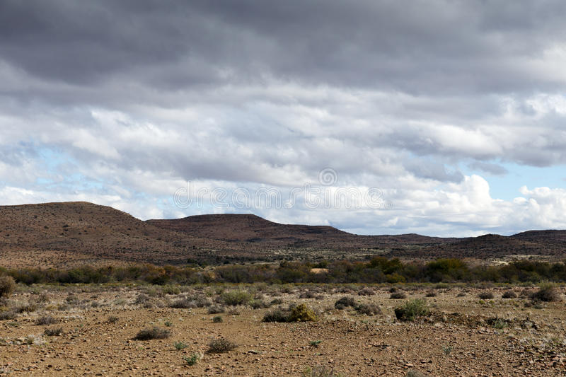 Dry land with mountains - Prince Albert. South Africa is a small town in the Western Cape in South Africa. It is located on the southern edge of the Great stock image