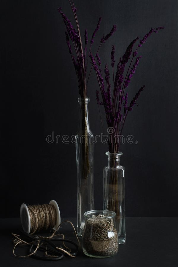 Dry lavender bouquets in crystal bottles royalty free stock photography