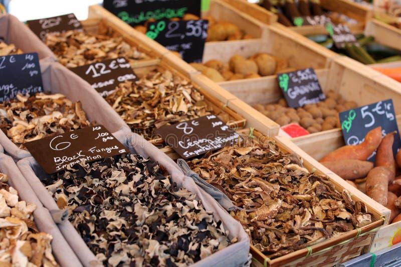 Dried mushrooms at a farmer market in France, Europe. Italian mushroom. Street French market at Nice. royalty free stock photography