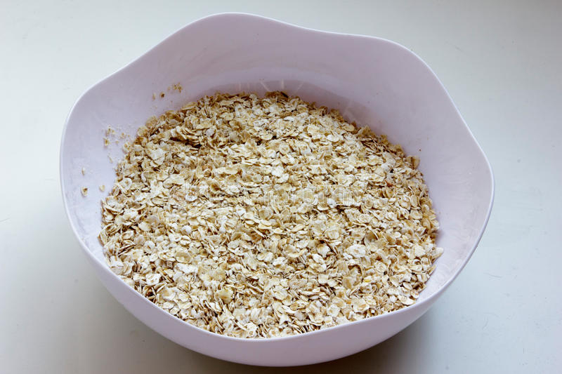 Dry oat cereal in a bowl stock photo