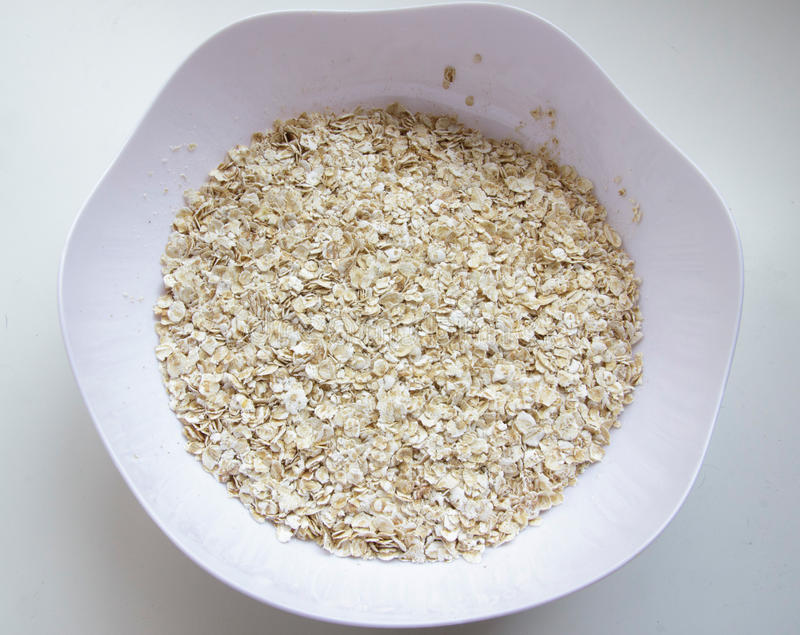 Dry oat cereal in a bowl stock images