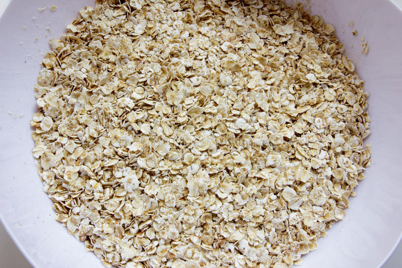 Dry oat cereal in a white plate stock photo