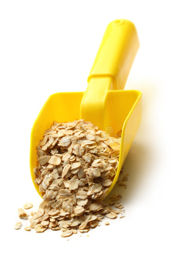 Dry oats cereal in spoon stock images