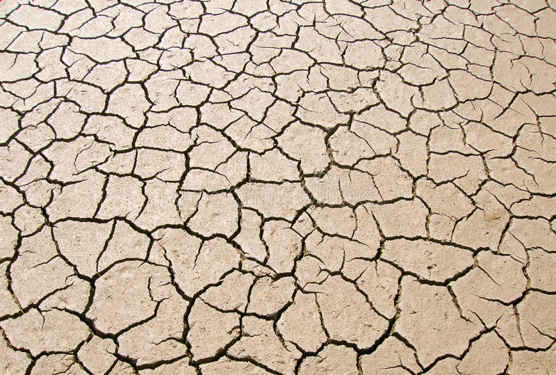 Dry parched earth. View from above of dry parched earth in dried up river bed stock image