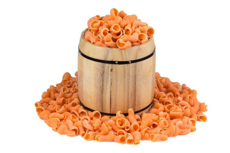 Dry pasta in the barrel on a white background stock image