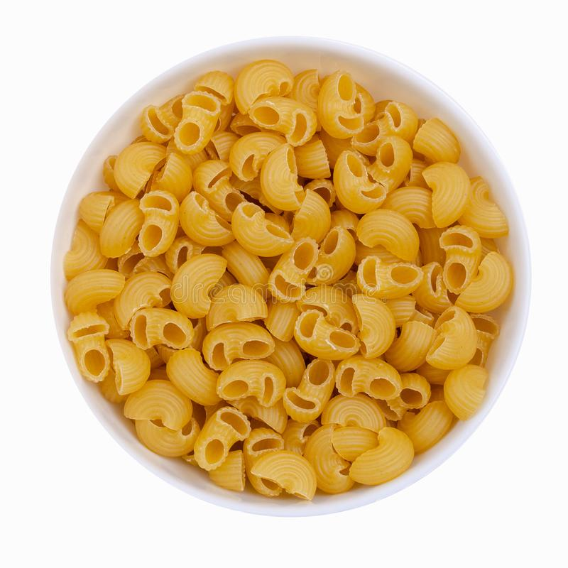 Dry pasta in a bowl stock photo