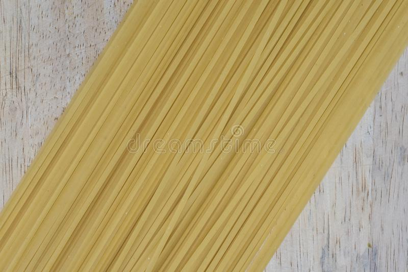 Dry pasta lined up on a board. Dry pasta lined up on a wooden board stock photography