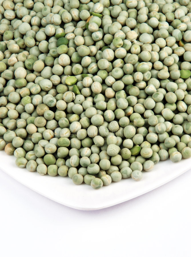 Dry pea. On a plate, white background royalty free stock photo