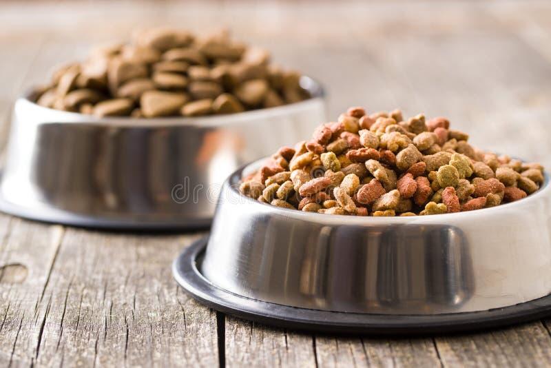 Dry pet food. Dry kibble food in metal bowl stock images
