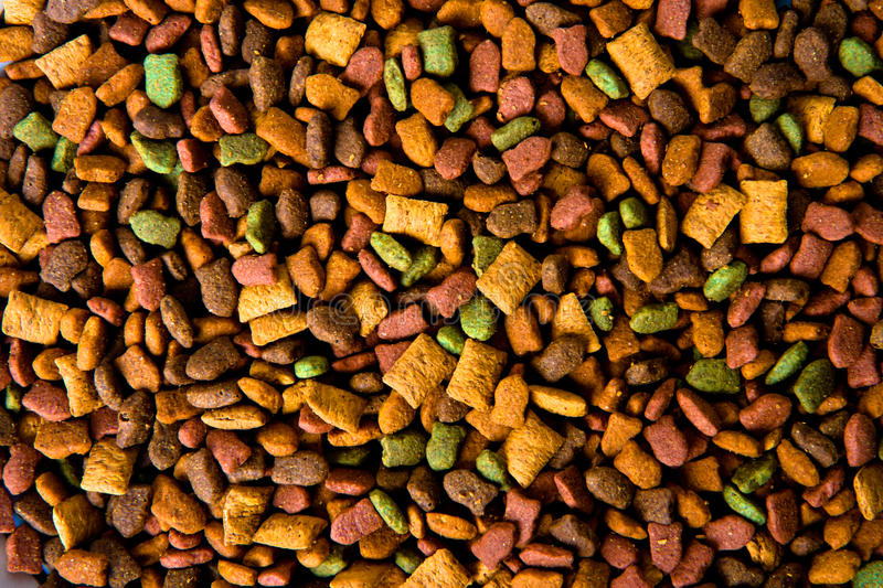 Dry pets food background. An image of dry pets food background, horizontal stock photography