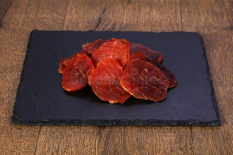 Dry pork meat. Heap over wooden royalty free stock image