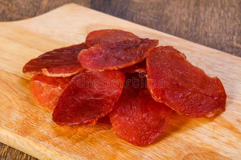 Dry pork meat. Heap over wooden royalty free stock photo