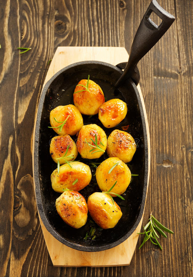 And dry Provencal herbs. Baked potatoes with rosemary and dry Provencal herbs stock image