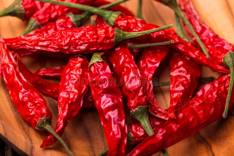 Dry red hot chili peppers. In a wooden bowl. Close up royalty free stock photos