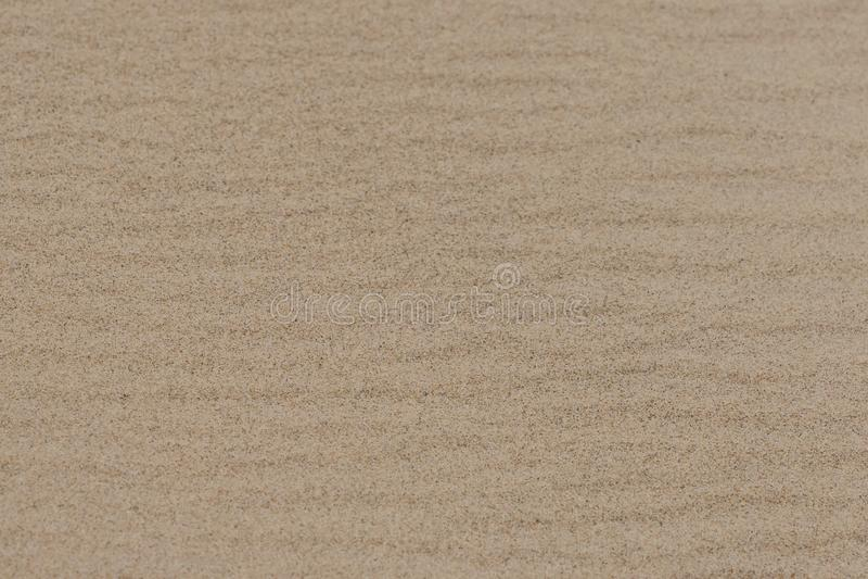 Dry, rippled, beach sand at the lake. Dry, rippled, beach sand at the lake on a hot summers day stock photo