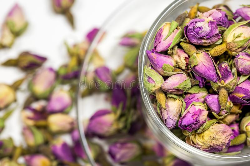 Dry rose buds and forget me not flowers, healthy herbal tea. Background stock photos