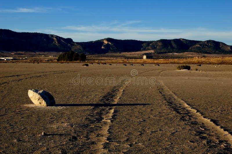 Dry salt lake - desert landscape. With trace of tires detail, global warming, climate change - Laguna de Salinas (Spain royalty free stock photo