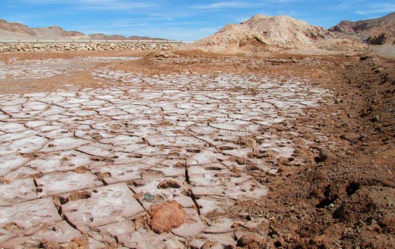 Dry salt soil in Valle de la Luna, Moon valley in San Pedro de Atacama desert. Panoramic view of empty dry solty desert soil in SanPedro de Atacama. Red rocks stock photo
