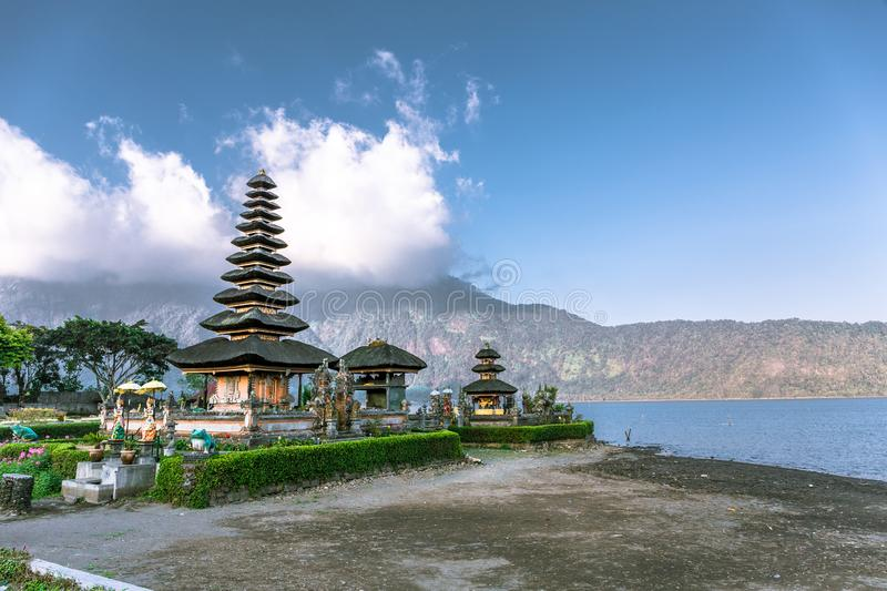 Ulun Danu Beratan Temple during dry season in Bali, Indonesia, Asia. Dry season at Ulun Danu Beratan Temple with a blue cloudy sky overhead and dry ground royalty free stock photography